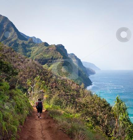 Female Hikers on Kalalau Trail Kauai stock photo, Kalalau trail path on Na Pali coast with three female hikers by Steven Heap