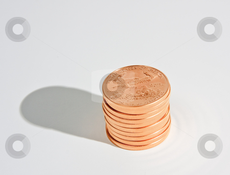 Stack of ten 1oz gold eagle coins stock photo, One Ounce gold eagle coins in a stack of ten with a shadow by Steven Heap