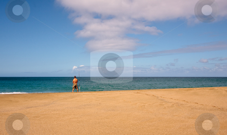 Sea fisherman on an empty beach stock photo, Rear view of fisherman on a wide sandy beach by Steven Heap