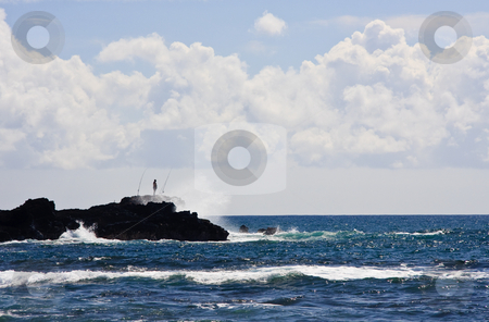 Silhouette of a fisherman on rocky headland stock photo, Silhouette of a fisherman on rocky headland off the coast of Kauai by Steven Heap