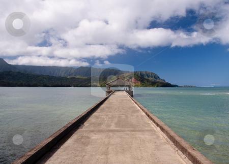 Pier at Hanalei Bay on Kauai stock photo, View down the pier at Hanalei in Kauai towards the Na Pali coast by Steven Heap