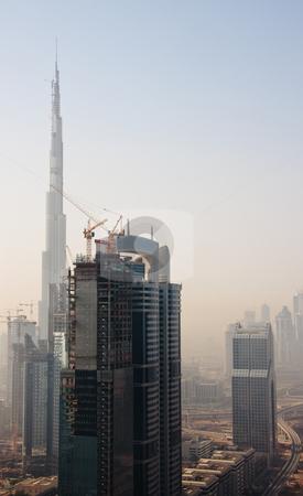 Cityscape of Dubai stock photo, Towering city skyscraper blocks in Dubai with Burj by Steven Heap