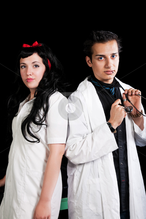 Healthcare Professionals stock photo, Two young, healthcare professionals standing back to back. by Brenda Carson