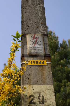 Warning stock photo, Warning sign on concrete electric pillar with number by Jolanta Dabrowska