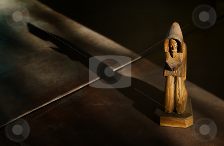 Wooden Statue of St. Francis stock photo, Wooden Statue of St. Francis in Afternoon Light with Shadow by Scott Griessel