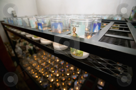 Devotional Candles in a Catholic Church stock photo, Devotional candles in a Hispanic Catholic church by Scott Griessel