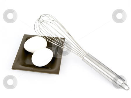 Eggs and wisk stock photo, Eggs and wisk on a white background by John Teeter