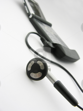 Earbud with Cell Phone stock photo,  by Kirsty Pargeter
