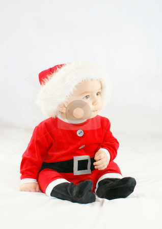 Baby santa stock photo, Cute baby boy in a santas outfit by Kirsty Pargeter