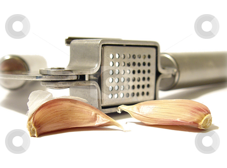 Garlic Clove with Press stock photo,  by Kirsty Pargeter