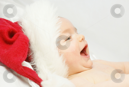 Baby santa stock photo, Baby boy laughing in santas hat by Kirsty Pargeter