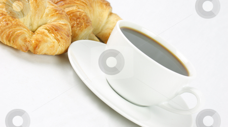 Coffee and croissants stock photo, Cup of coffee and croissants by Kirsty Pargeter