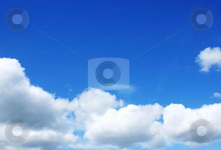 Blue sky stock photo, Blue sky with fluffy white clouds by Kirsty Pargeter