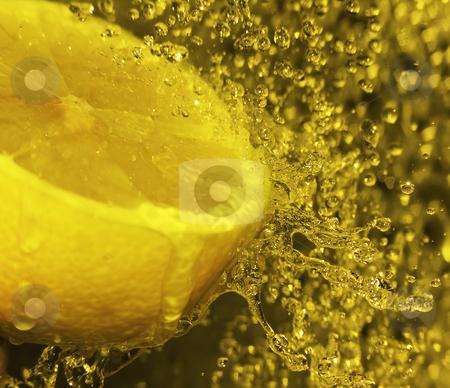 Lemon splash stock photo, Water splashing onto a lemon by Kirsty Pargeter