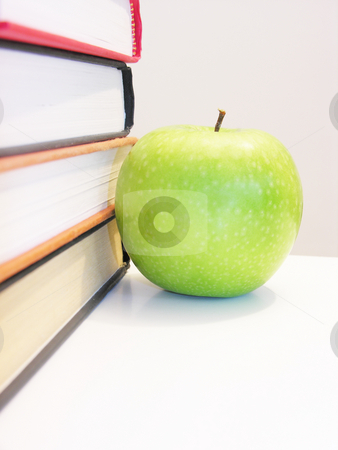 Apple by stacked books stock photo,  by Kirsty Pargeter