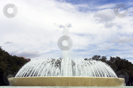 Fountain stock photo, A large round fountain in the center of a city street by Kevin Tietz