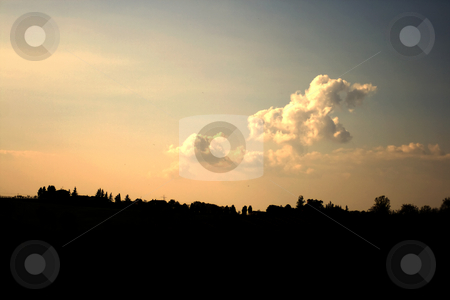 Clouds on silhouette stock photo, Silhouette of country under great clouds by Fabio Alcini