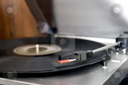Turntable stock photo, Closeup of a turntable playing a vinyl record by Fabio Alcini