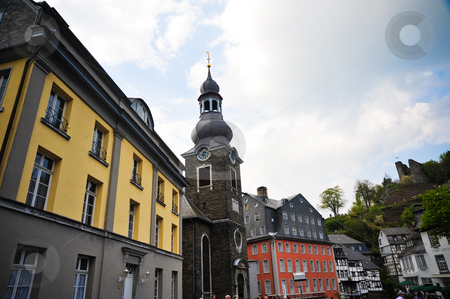 Monschau Germany stock photo, Stone church and yellow building in Monschau Germany by Jaime Pharr