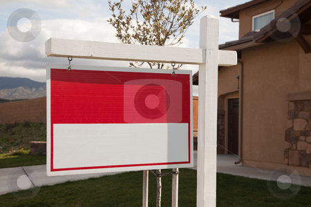 Blank Real Estate Sign in Front of House stock photo, Blank Red Real Estate Sign in Front of House Ready for Your Own Copy. by Andy Dean