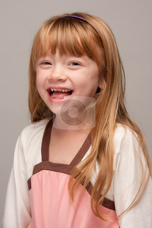 Portrait of an Adorable Red Haired Girl stock photo, Portrait of an Adorable Red Haired Girl on a Grey Background. by Andy Dean