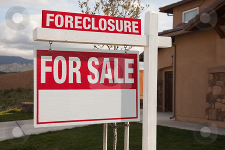 Foreclosure For Sale Real Estate Sign stock photo, Foreclosure For Sale Real Estate Sign in Front of House Ready for Your Own Copy. by Andy Dean