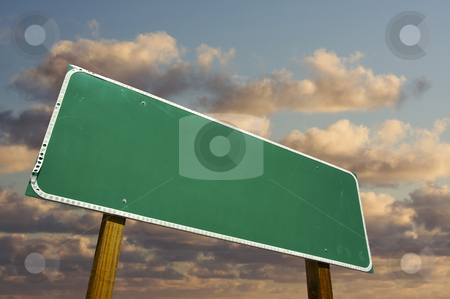 Blank Green Road Sign stock photo, Blank Green Road Sign with dramatic clouds and sky. by Andy Dean