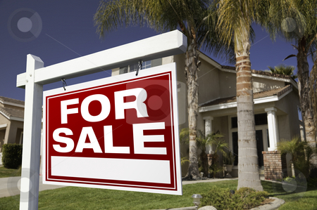 For Sale Real Estate Sign and House stock photo, For Sale Real Estate Sign in Front of House. by Andy Dean