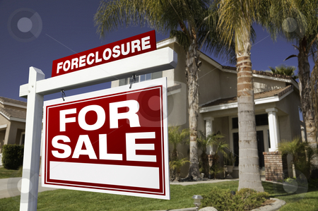 Foreclosure For Sale Real Estate Sign and House stock photo, Foreclosure For Sale Real Estate Sign in Front of House. by Andy Dean