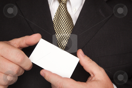 Businessman Holding Blank Business Card stock photo, Businessman with Coat and Tie Holding Blank Business Card. by Andy Dean