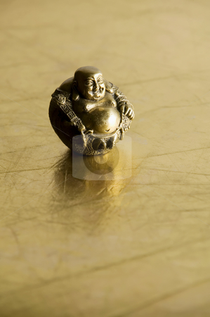 Buddha Statue stock photo, Buddha statue with big belly on shiny gold background by Scott Griessel