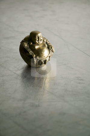 Buddha Statue stock photo, Buddha statue with big belly on shiny silver background by Scott Griessel
