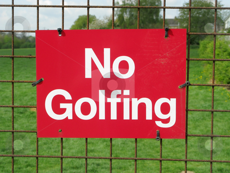 No golfing sign on a park fence. stock photo, No golfing sign on a park fence. by Stephen Rees