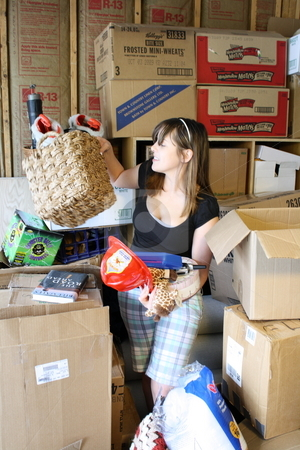 Girl surrounded by boxes stock photo, A girl getting overwhelmed with sorting through boxes. by Chris Torres