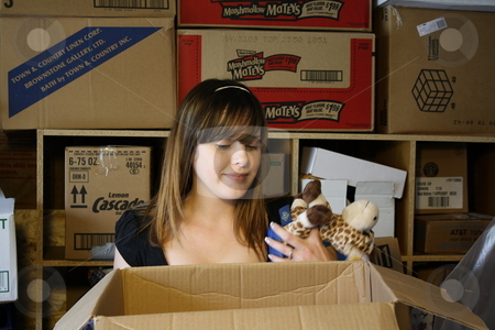 Girl surrounded by boxes stock photo, Girl gets overwhelmed in boxes by Chris Torres