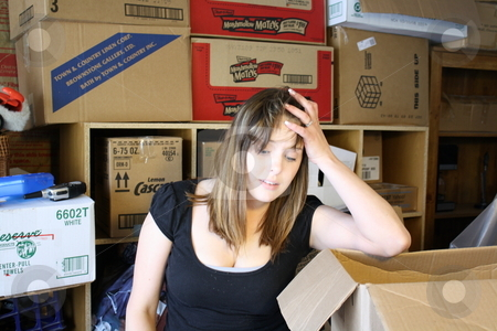 Girl overwhelmed in boxes stock photo, A girl gets overwhelmed in boxes and clutter by Chris Torres