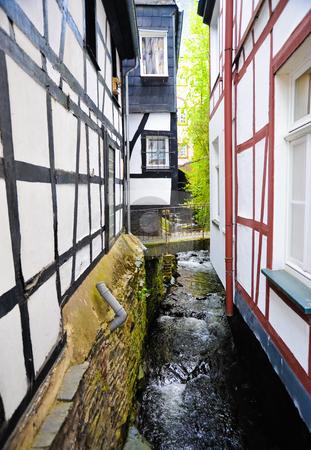 Monschau  stock photo, Stream between buildings in Monschau Germany by Jaime Pharr