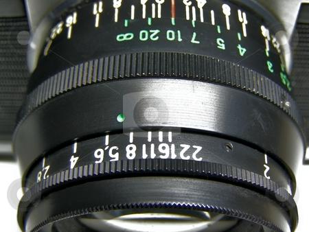 Objective stock photo, Objective with aperture and zoom scales by Sergej Razvodovskij