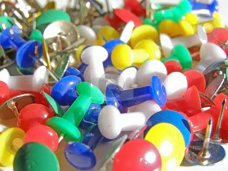 Thumb tacks stock photo, Scattered multicolored thumb tacks and pins by Sergej Razvodovskij