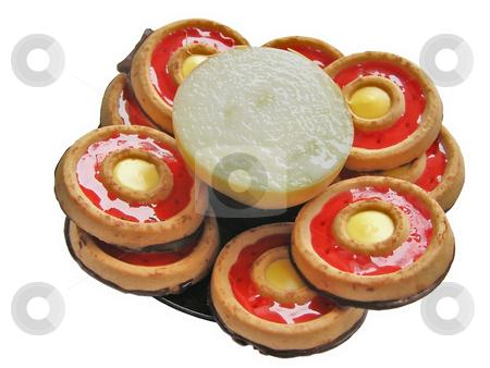 Incompatibility stock photo, Half of onion among the sweet cakes by Sergej Razvodovskij