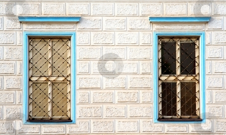 Windows with bars stock photo, Blue windows with bars by Juraj Kovacik