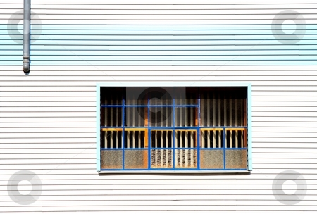 Window and gray pipe stock photo, Window on cheap plastic facade by Juraj Kovacik