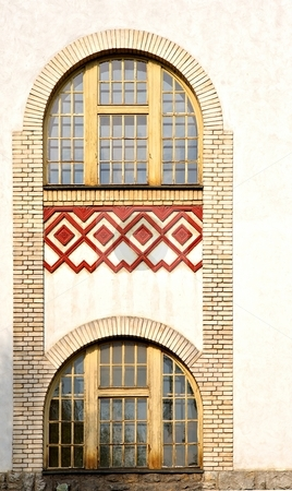Tall window stock photo, Window on a old facade with red bricks by Juraj Kovacik
