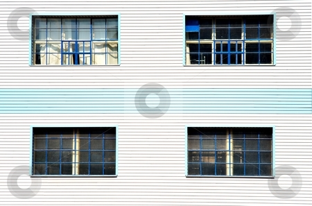 Windows on blue white facade stock photo, Window on cheap plastic facade by Juraj Kovacik