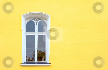 Window with reflection stock photo, White window on yellow facade with reflection of buildings by Juraj Kovacik