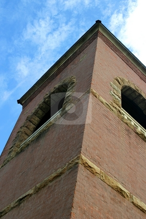 Church Tower stock photo, Church tower corner up view with sky in the background. by Henrik Lehnerer