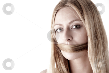 Speak no eveil, silenced by own hair stock photo, Portrait of a woman with her own hair in fornt of her mouth so she can't speak by Frenk and Danielle Kaufmann