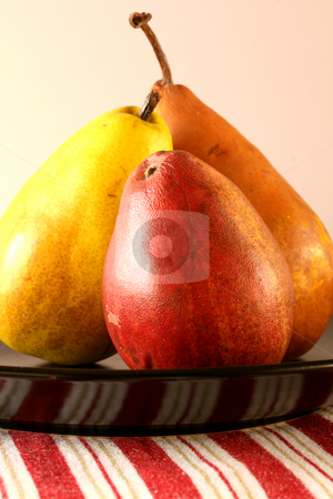 Pears Still Life stock photo, Three golden/orange pears leaning towards the middle by Linda Schhirmbeck