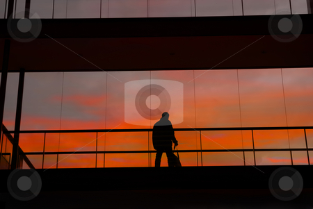 Worker stock photo, Business man in the modern buildind at sunset by Rui Vale de Sousa