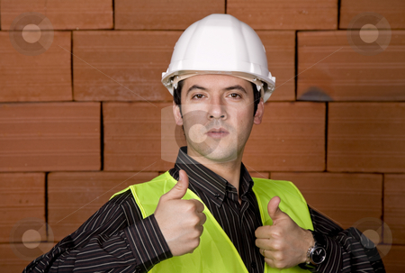 Engineer stock photo, Engineer with white hat and a brick wall as background by Rui Vale de Sousa